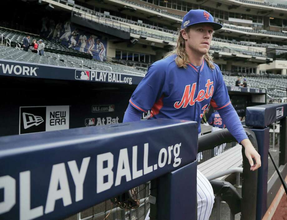 New York Mets starting pitcher Noah Syndergaard steps onto the field for a team workout Tuesday at Citi Field. Photo: JULIE JACOBSEN — THE ASSOCIATED PRESS  / Copyright 2016 The Associated Press. All rights reserved.
