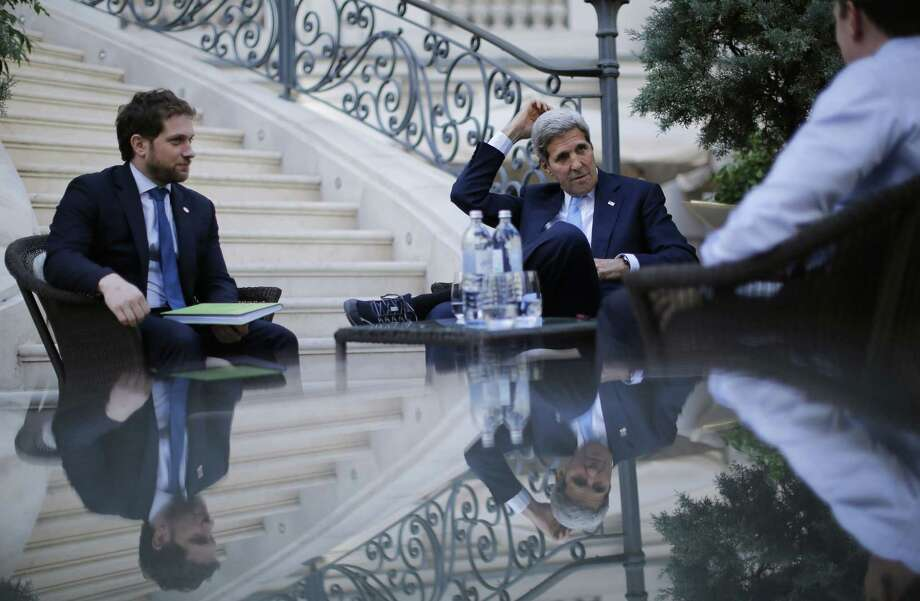 U.S. Secretary of State John Kerry, centre, and State Department Chief of Staff Jon Finer, left, meet with members of the U.S. delegation Friday at the garden of the Palais Coburg hotel where the Iran nuclear talks meetings are being held in Vienna, Austria. Photo: Associated Press  / Pool Reuters