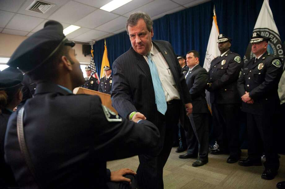 Gov. Chris Christie greets Camden County Police Officer Tyrrell Bagby after addressing the Camden County Police Force on the sweeping public safety reforms and the progress made together with the City of Camden to bring down crime, Monday, Nov. 2, 2015. Photo: John Ziomek/Camden Courier-Post Via AP   / Camden Courier-Post