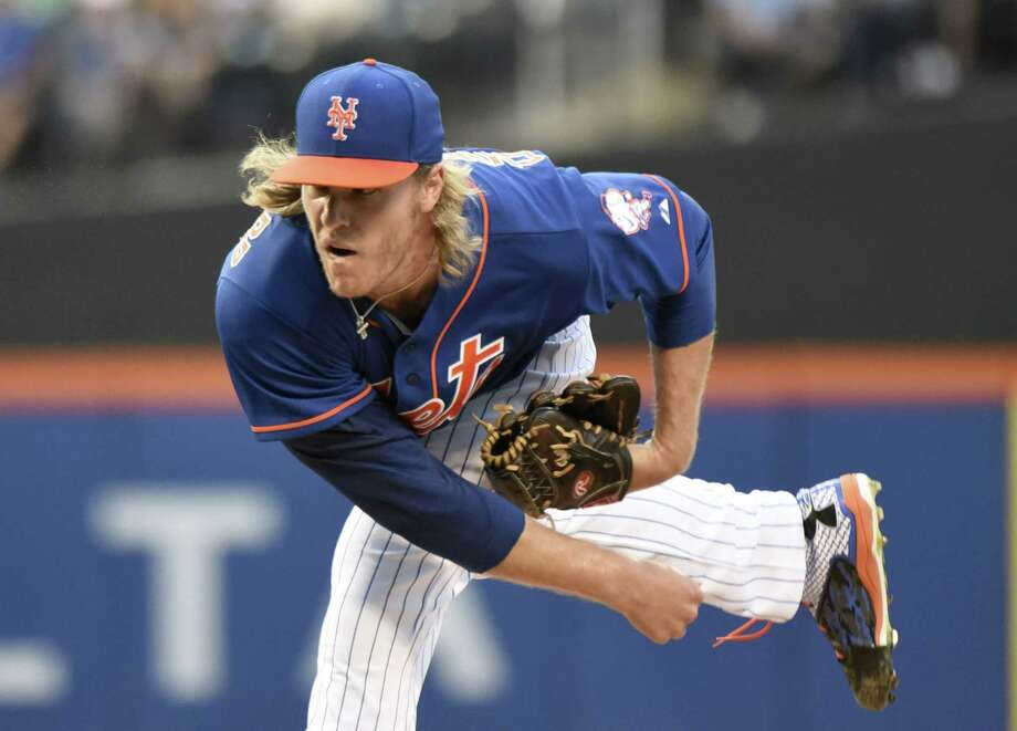 New York starter Noah Syndergaard delivers during the first inning of Friday's win over the Arizona Diamondbacks at Citi Field in Queens. Photo: Bill Kostroun — The Associated Press  / FR51951 AP