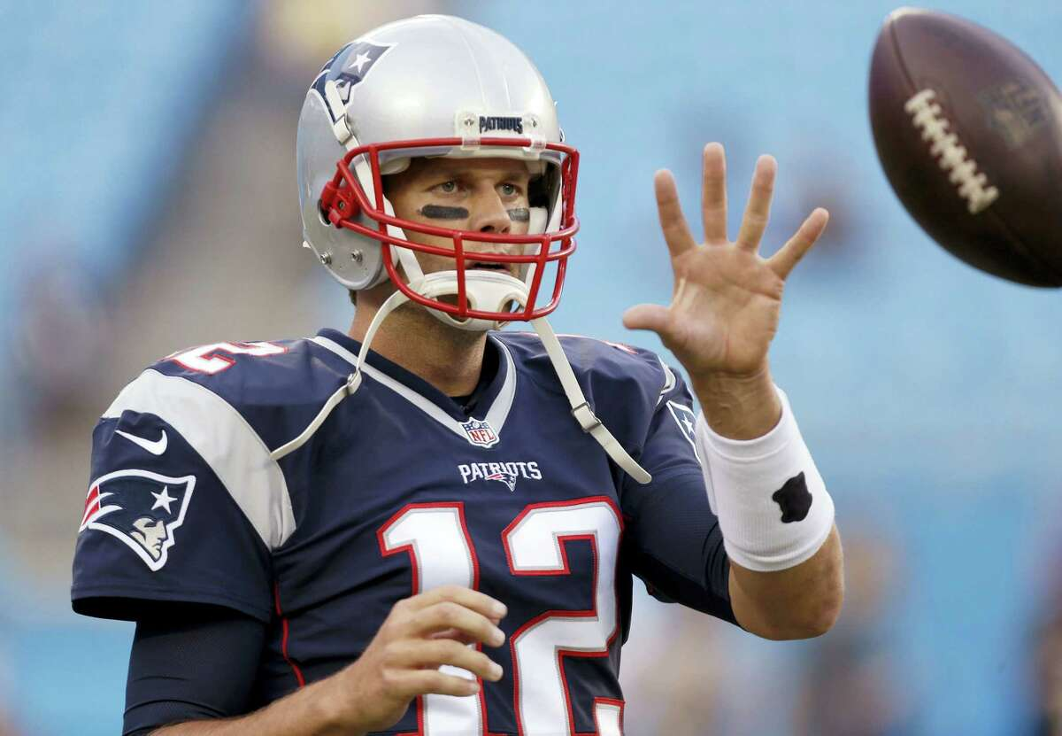 In this Aug. 26, 2016 photo, New England Patriots quarterback Tom Brady warms up before an NFL preseason football game against the Carolina Panthers in Charlotte, N.C. A lot has happened in the first month of the season since Tom Brady began his four-game suspension. He returned to the team on Monday, Oct. 3.