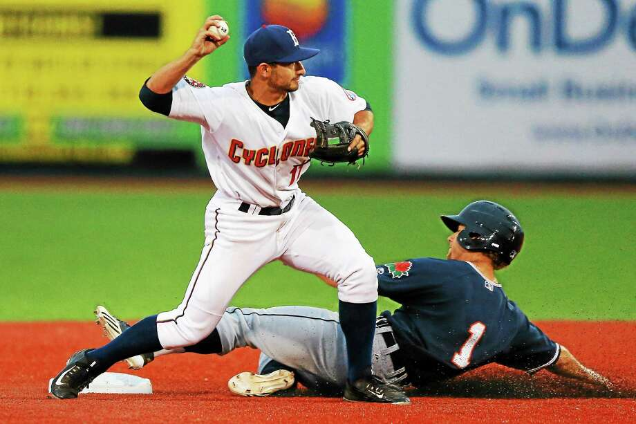 Brooklyn Cyclones second baseman Vinny Siena (11) throws to first as the Connecticut Tigers' Brett Pirtle (1) slides into second during a June 25 game at MCU Park in Brooklyn. Photo: Gordon Donovan — The Associated Press  / Gordon Donovan
