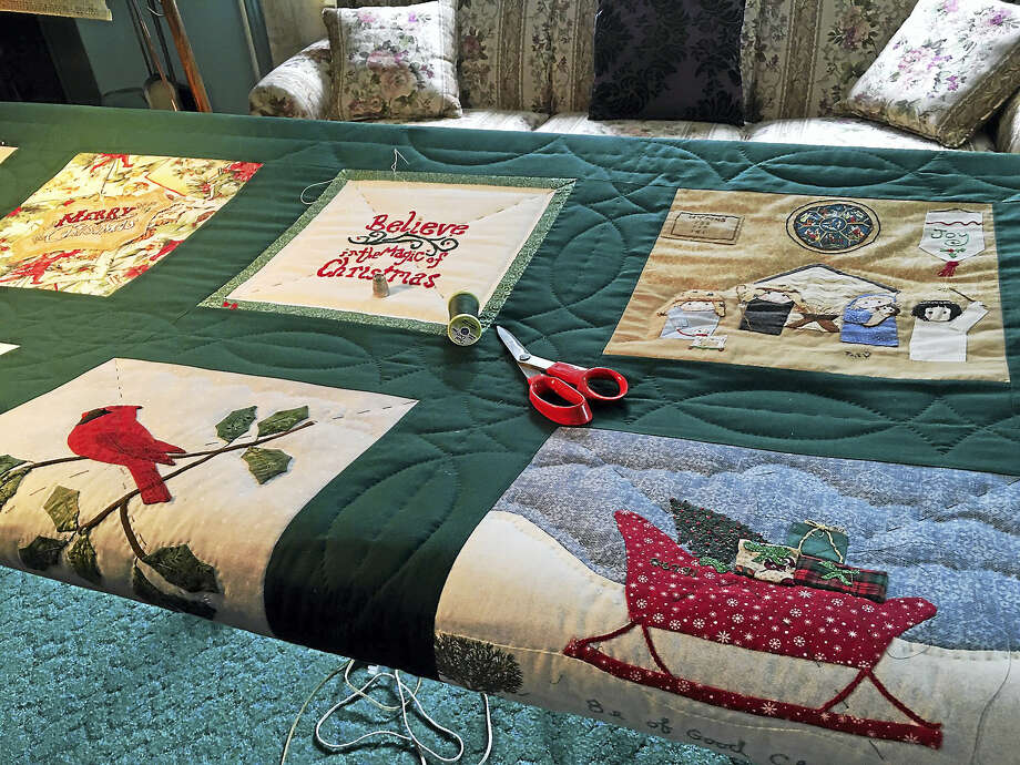 HARWINTON WOMAN'S CLUB NEWS      QUILT PROJECT 2016  QUILTING BEES HELD DURING THE SUMMER  Original, hand-embroidered, hand-appliqued and hand-quilted...Those are some of the qualities of the Harwinton woman's Club's 38th annual picture quilt and this year the theme is THE MIRACLE OF CHRISTMAS.  Each year members create pictures with fabric which are sewn together and quilted during the Summer at Quilting Bees.  The finished project is raffled and the proceeds go to scholarships and local charities.  The quilt will be on display at the Harwinton Public Library during the month of August, will be shown at various venues during September.  October is the month to buy tickets at the Harwinton Fair and at the Thomaston Savings Bank.  The club is well-known for their historically themed quilts.  The Columbus quilt hangs in the Harwinton Consolidated School, our quilts are in the Mark Twain House and the Harriet Beecher Stowe Museum and the Signature Quilt hangs in the Harwinton Town Hall.  Tickets may be purchased from members from September 3 through November 3rd at $3.00 each.                                                Submitted by Pat Green and Barbara Gleason Photo: Journal Register Co.