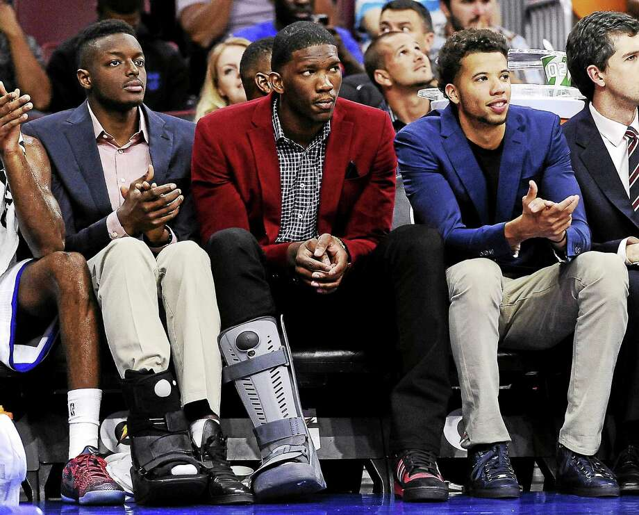 The Philadelphia 76ers' Joel Embiid, middle, will have a second surgery on his foot. Photo: Michael Perez — The Associated Press File Photo  / FR168006 AP
