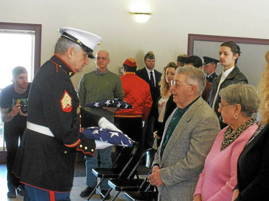 Stephen Underwood - Special to The Register Citizen Joseph Bosco is presented with an American flag in honor of his three brothers as the 313th, 314th, and 315th Veteran's of the Month. The flag will fly at the All War's Memorial until April 7. Photo: Journal Register Co.