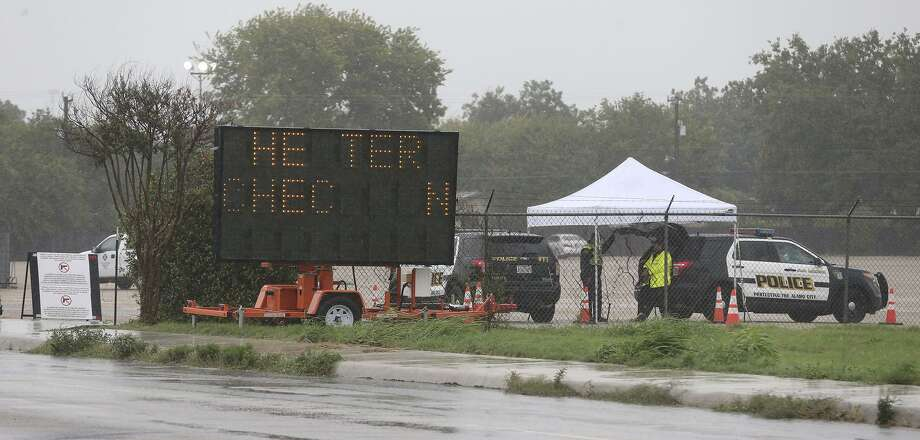 Police stand by Saturday August 26, 2017 on Gembler Road where hurricane evacuees can check in. Hurricane Harvey apperas t be moving north. Photo: John Davenport, STAFF / San Antonio Express-News / ©John Davenport/San Antonio Express-News