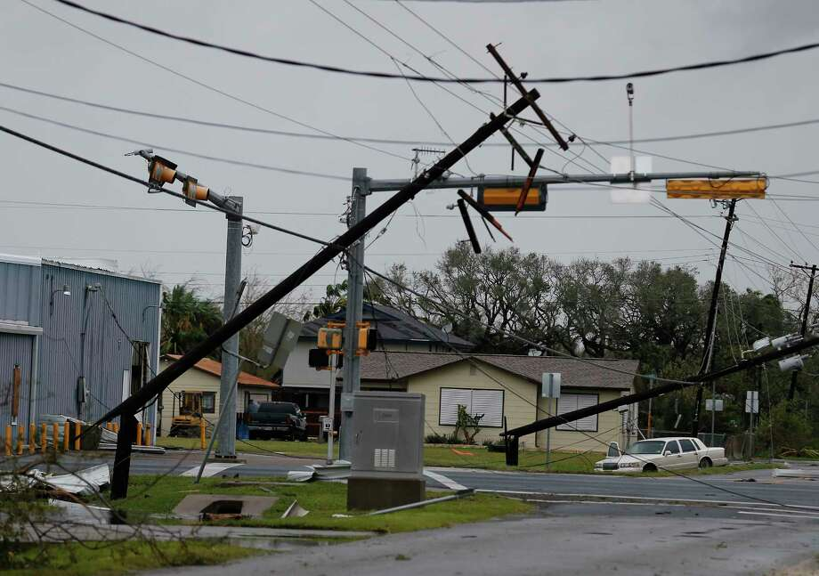 Broken and leaning utility poles littered Rockport after Hurricane Harvey. Photo: Kin Man Hui, San Antonio Express-News / ©2017 San Antonio Express-News
