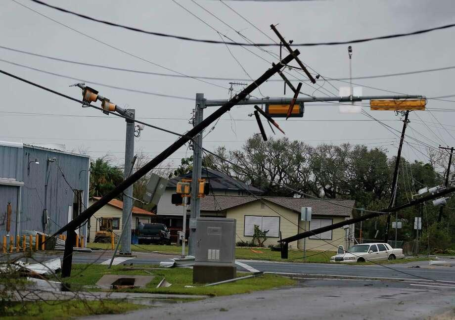 Broken and leaning utility poles littered Rockport after Hurricane Harvey. Photo: Kin Man Hui, San Antonio Express-News / ©2017 San Antonio Express-News