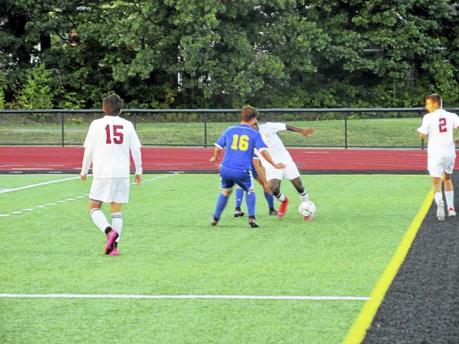 Naseem Thompson, working the ball in front of Dominic DaSilva (16), scored all three of Torrington's goals in a tie with Seymour Monday at the Robert H. Frost Sports Complex. Photo: Photo By Peter Wallace