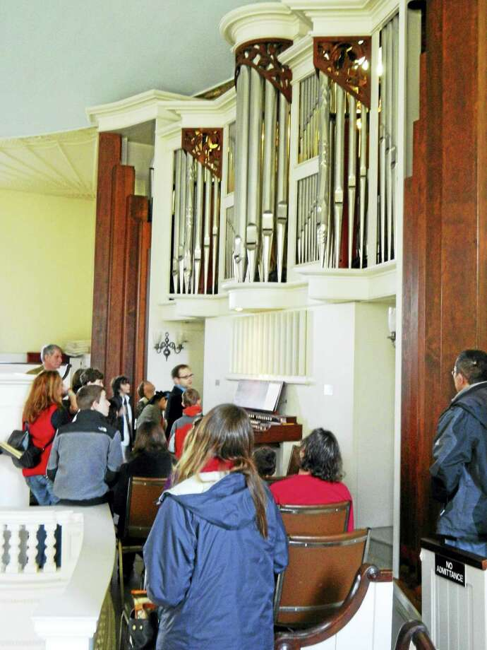 Young people and parents get an up-close look at one of New Haven's great pipe organs. Photo: Contributed