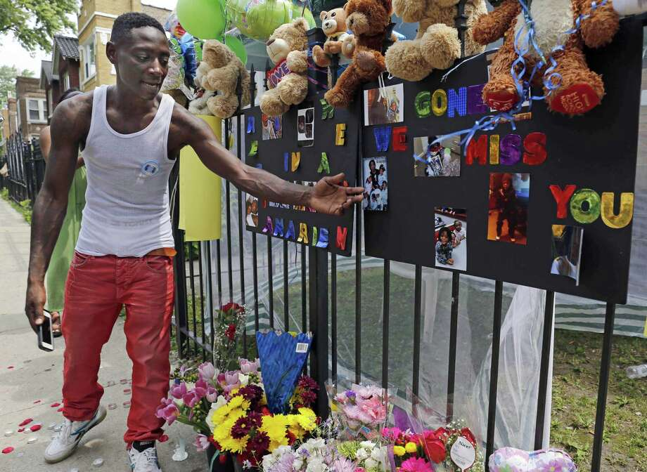 FILE - In this July 6, 2015, file photo, Antonio Brown, father of Amari Brown, speaks near a sign honoring his son, in Chicago. Seven-year-old Amari was among three people who were shot and killed overnight during a weekend outbreak of gun-related violence in Chicago. Homicides and shooting incidents in Chicago are up roughly 20 percent from the same period last year. (AP Photo/Christian K. Lee, File) Photo: AP / AP