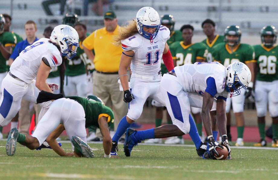 Oak Ridge defensive end Joseph Ossai (49) recovers a fumble by Klein Forest quarterback Kenneth Morris (1) and returns it for a 53-yard touchdown during the first quarter of a non-district high school football game Thursday, Sept. 8, 2016, at Klein Memorial Stadium in Spring. Photo: Jason Fochtman, Staff / Jason Fochtman