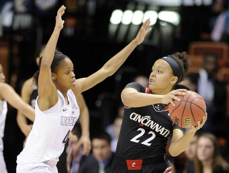 Cincinnati's Bianca Quisenberry is guarded by UConn's Moriah Jefferson on Saturday in Uncasville. Photo: Fred Beckham — The Associated Press  / FR153656 AP