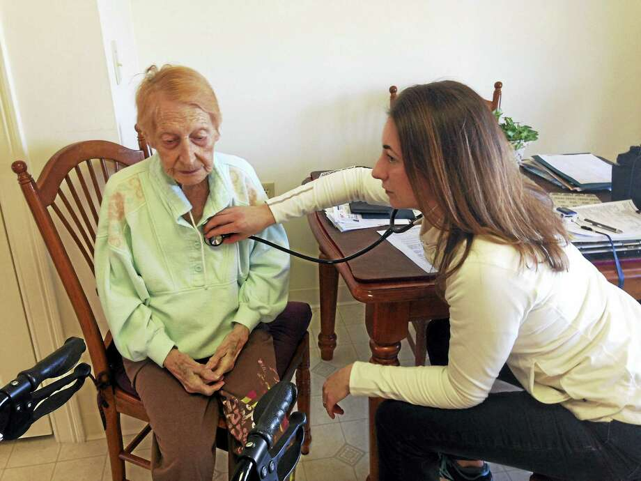 Florence Jamieson, 95, meets with Darcy Ingres, a registered nurse who works with the Farmington Valley Visiting Nurse Association, at Jamieson's home in Farmington. The agency received an overall four-star rating. Photo: CONTRIBUTED PHOTO