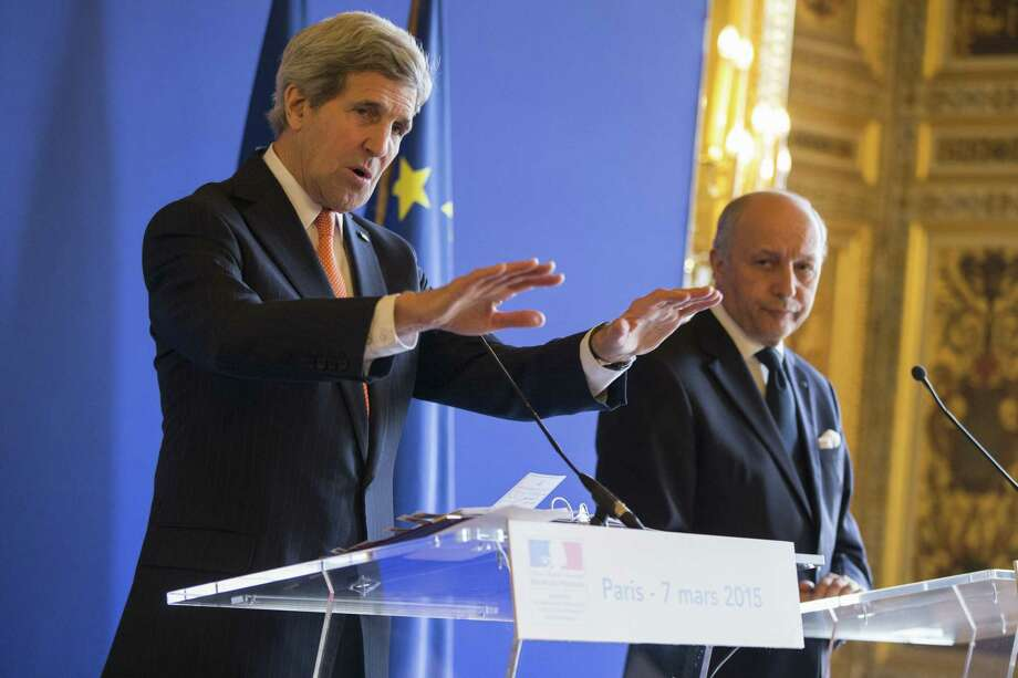 Secretary of State John Kerry, left, speaks to the media during a news conference with French Foreign Minister Laurent Fabius, on Saturday, March 7, 2015, in Paris. Kerry is meeting with the foreign ministers of France, Germany, and Britain to brief them on the status of nuclear negotiations with Iran. (AP Photo/Evan Vucci) Photo: AP / POOL