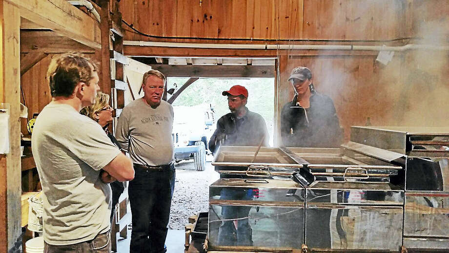 N.F. Ambery photo Volunteer Harry Gerowe of Woodbury showed visitors the sugaring process during Maple Syrup Demonstrations at Flanders Nature Center & Land Trust. Photo: Journal Register Co.
