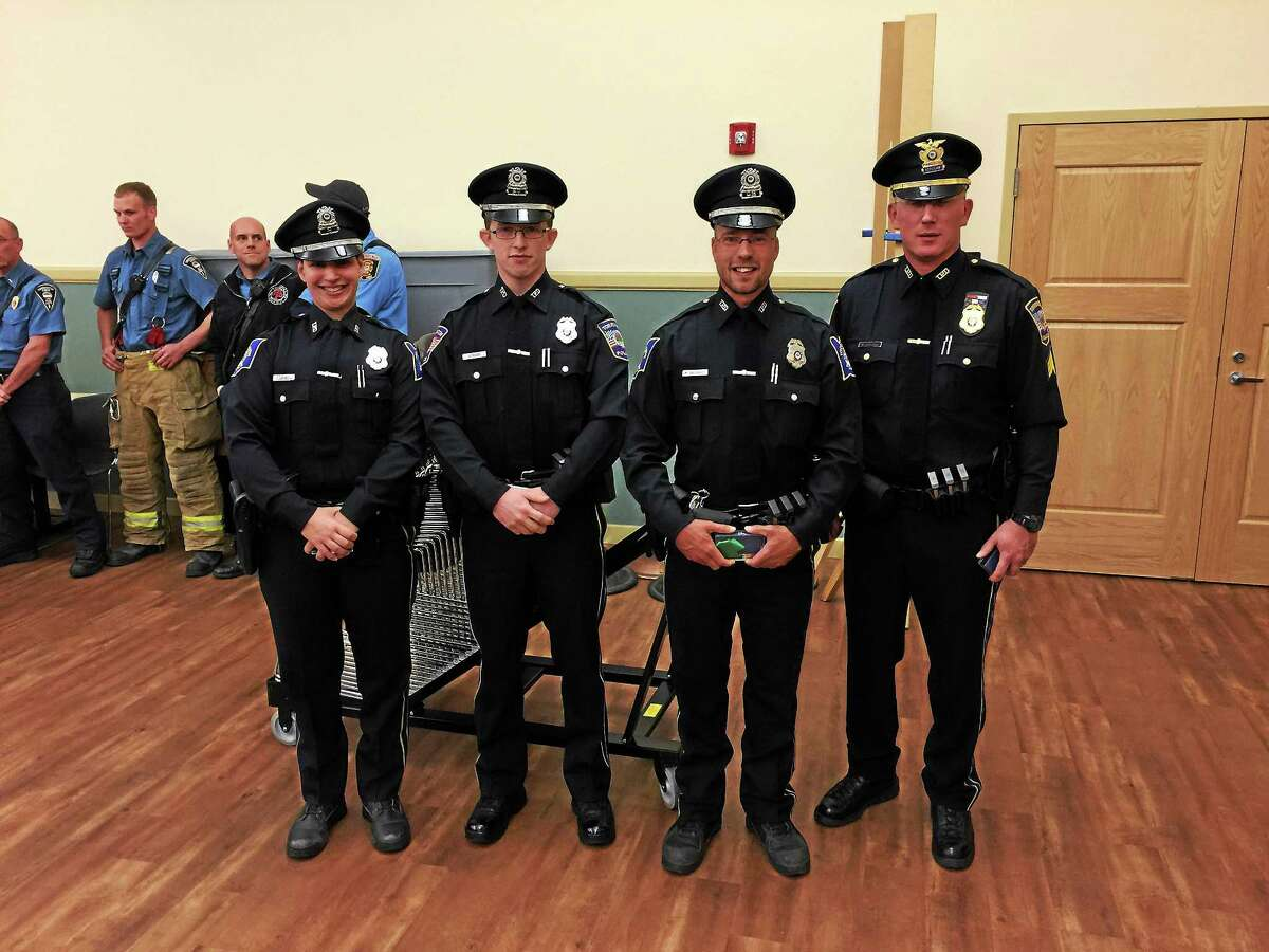 Four Torrington police officers were awarded medals Wednesday evening for their response to the March shooting and fire on Highland Avenue. From left: Officer Farren Dinunzio, Officer James Foley, Officer Matthew Gallagher, Sgt. Matthew Southard.