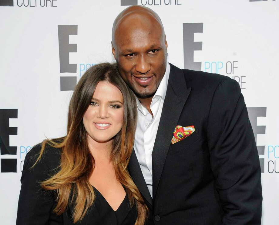"""In this April 30, 2012, file photo, Khloe Kardashian Odom and Lamar Odom from the show """"Keeping Up With The Kardashians"""" attend an E! Network upfront event at Gotham Hall in New York. Photo: AP Photo/Evan Agostini, File   / AGOEV"""