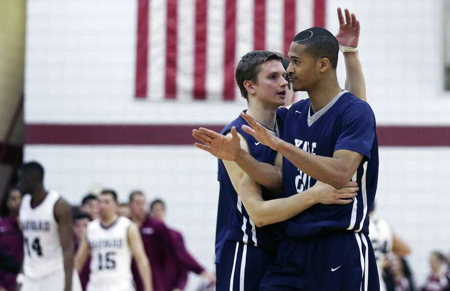 Yale guard Javier Duren, right, celebrates with teammate Makai Mason during the second half of the Bulldogs' 62-52 win over Harvard on Friday night in Cambridge, Mass. Photo: Charles Krupa — The Associated Press  / AP