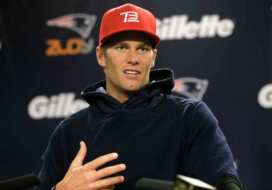 New England Patriots quarterback Tom Brady speaks with members of the media before practice on Wednesday in Foxborough, Mass. Photo: Steven Senne — The Associated Press  / AP