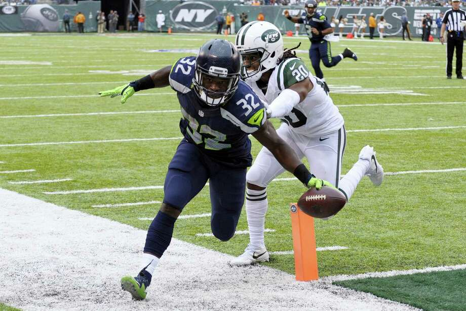Seahawks running back Christine Michael scores a touchdown against the Jets on Sunday. Photo: Bill Kostroun — The Associated Press  / FR51951 AP
