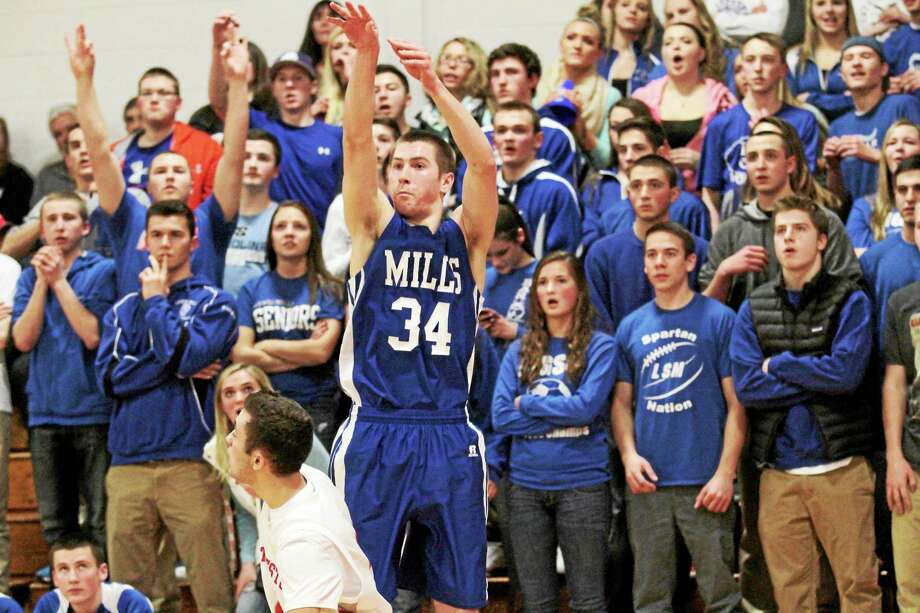 Marianne Killackey - Special to Register Citizen Lewis Millsí Benjamin Lewis puts up a jump shot in his teamís win over Northwestern. Photo: Journal Register Co. / 2014