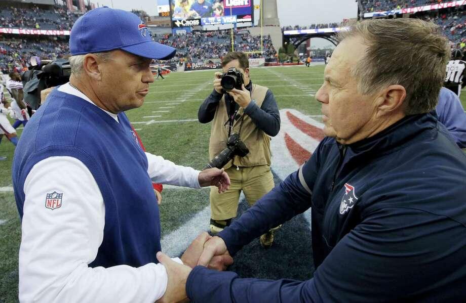 Bills head coach Rex Ryan, left, speaks with Patriots coach Bill Belichick after Sunday's game. Photo: Steven Senne — The Associated Press  / Copyright 2016 The Associated Press. All rights reserved.