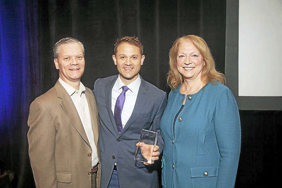 Contributed photo From left are Jim Kane, head of Private Risk Management Association, Ericson Insurance vice president Kurt Thoennessen and Lisa Linsay, who presented Thoennessen with the JoAnn Heltibridle Award. Photo: Journal Register Co.