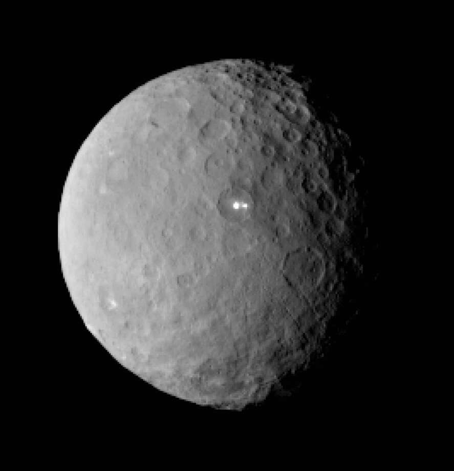 FILE - This Feb. 19, 2015 file image provided by NASA shows the dwarf planet Ceres, taken by the space agency's Dawn spacecraft from a distance of nearly 29,000 miles (46,000 kilometers). On Friday, March 6, 2015, NASAís Dawn spacecraft arrives at the mysterious dwarf planet located in the asteroid belt between Mars and Jupiter after a nearly eight-year journey. Dawn, which previously visited Vesta, also in the asteroid belt, has already beamed back images of Ceres as it closes in. (AP Photo/NASA/JPL-Caltech/UCLA/MPS/DLR/IDA, File) Photo: AP / NASA/JPL-Caltech/UCLA/MPS/DLR/IDA
