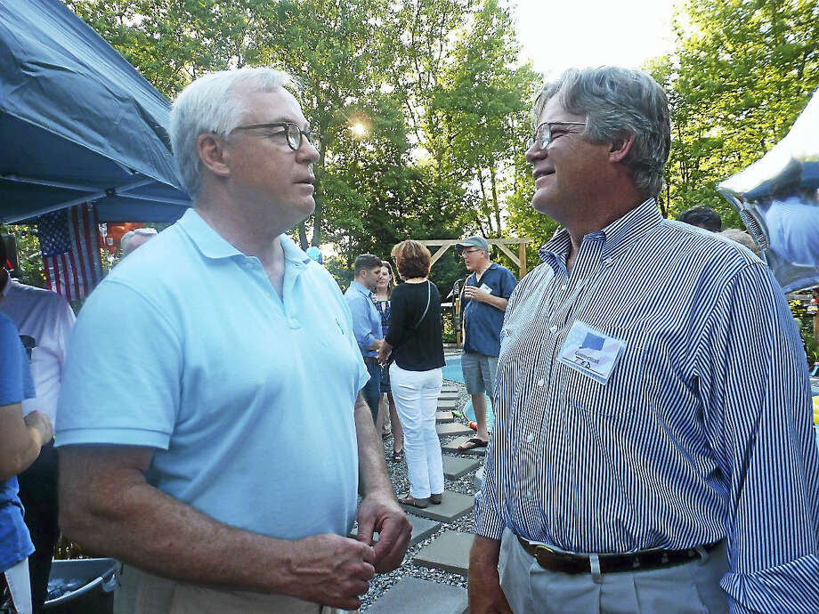 Contributed photoSen. Ted Kennedy, Jr., left, talks with 64th State Representative Candidate Bill Riiska at an event hosted by Audrey Blondin in Litchfield on July 17. Photo: Journal Register Co.