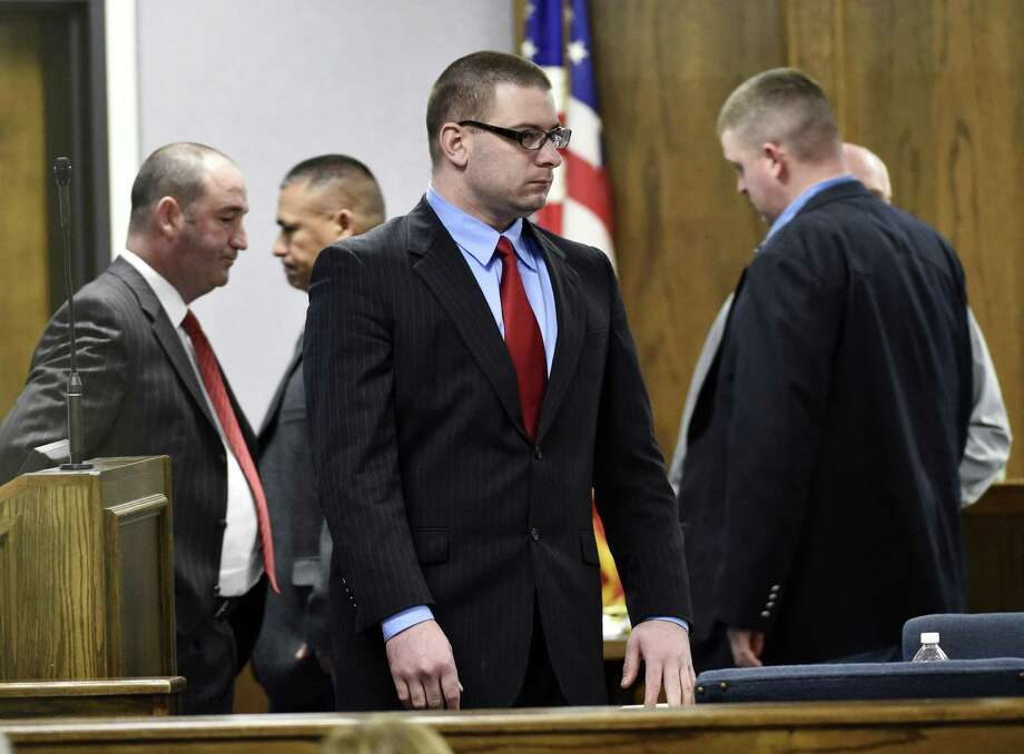 Former Marine Cpl. Eddie Ray Routh stands during his capital murder trial at the Erath County, Donald R. Jones Justice Center in Stephenville Texas, on Tuesday, Feb. 24, 2015. Routh, 27, of Lancaster, is charged with the 2013 deaths of Chris Kyle and his friend Chad Littlefield at a shooting range near Glen Rose, Texas. (AP Photo/The Dallas Morning News, Michael Ainsworth, Pool) Photo: AP / Pool The Dallas Morning News