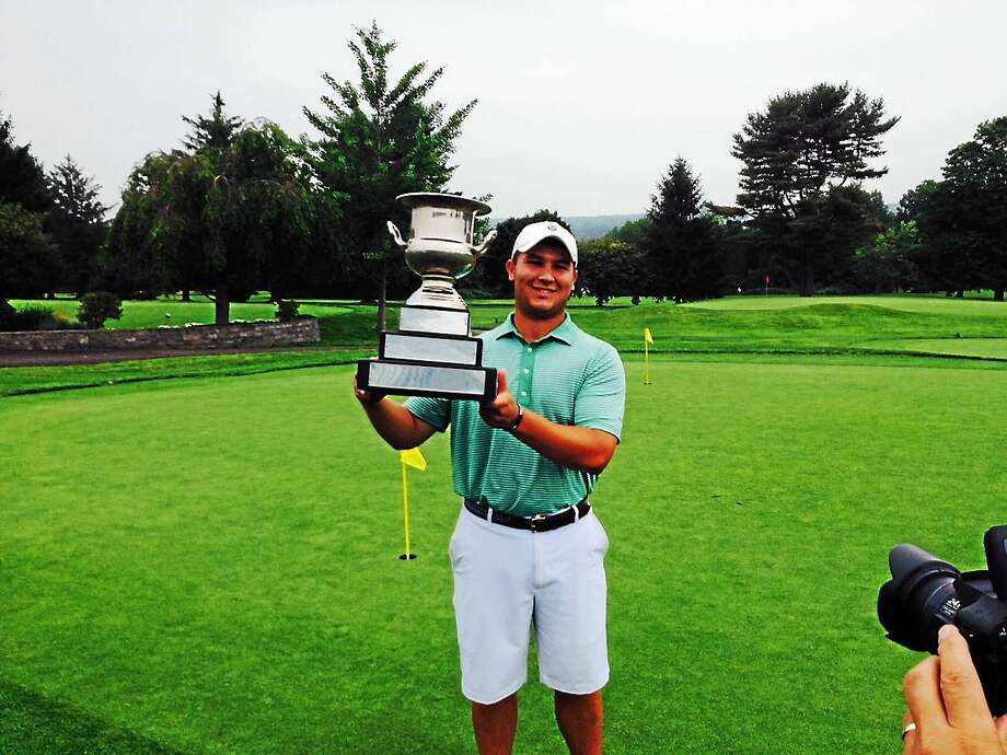 Fairfield Prep rising senior Andrew Sciarretta displays the hardware as the 74th Connecticut Junior Amateur champion on Thursday at Watertown Golf Club. Photo: Joe Morelli — Register