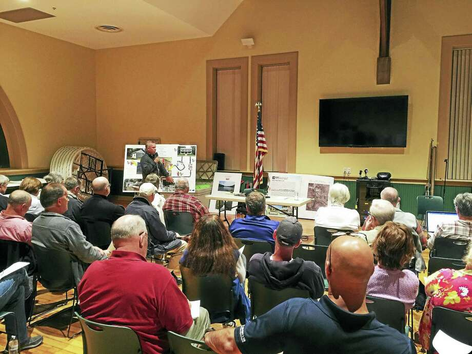 Ben Lambert - The Register CitizenNew Hartford residents discuss the possibility of putting the town water and sewer systems up for sale Thursday evening. Photo: Journal Register Co.