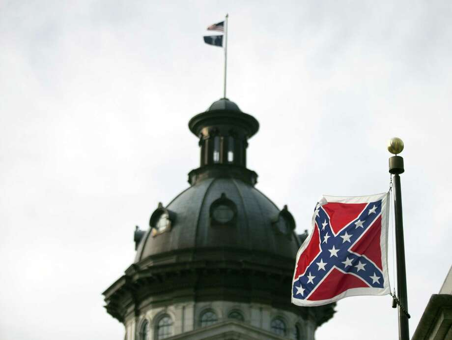 A Confederate battle flag flies in front of the South Carolina statehouse Wednesday, July 8, 2015, in Columbia, S.C. Photo: (AP Photo/John Bazemore)  / AP
