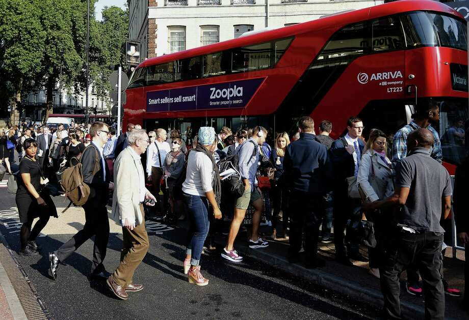 Commuters queue for buses as tube drivers are on strike in London Thursday. Photo: Associated Press  / AP