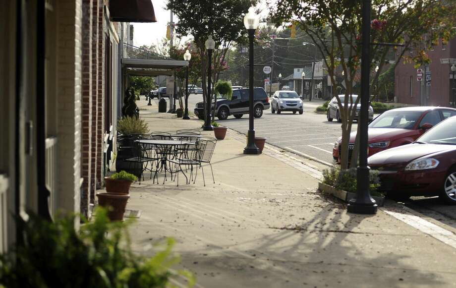 """This photo taken Wednesday, July 8, 2015, shows a quiet sidewalk in downtown Monroeville, Ala., the hometown of """"To Kill a Mockingbird"""" author Harper Lee. Lee's second novel, """"Go Set a Watchman,"""" is due for release July 14, 2015. Photo: (AP Photo/Jay Reeves) / AP"""