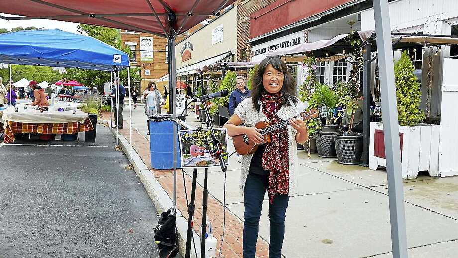 Photo by N.F. AmberySinger-songwriter Ukebaby Kim (also known as Kim Noble) performed original and cover songs at the Winsted Friends of Main Street's 19th Annual Fall Foliage Festival along the north side of Main Street in Winsted on Saturday. The event featured 40 local food and craft vendors; children's games; cheerleading routine demonstrations and a bake sale by the Gilbert-Northwestern Regional High School squad; a demonstration of disabilities-assisting dogs; and a clown entertainer from the Winsted Lions Club 9056. Organizers estimated the Festival was attended by an estimated 700 visitors throughout the day, despite drizzly mid-50s-degree weather. Photo: Journal Register Co.