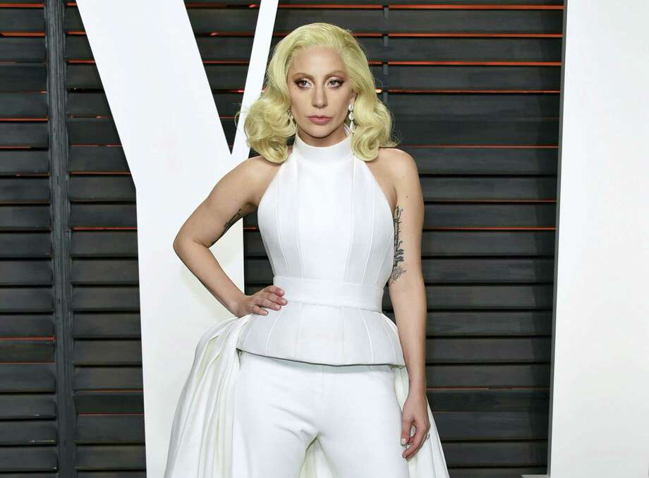 """In this Feb. 28, 2016 photo, Lady Gaga arrives at the Vanity Fair Oscar Party in Beverly Hills, Calif. Lady Gaga is choosing the intimacy of dive bars over arenas to showcase songs from her new album, """"Joanne."""" Photo: Photo By Evan Agostini/Invision/AP, File  / Invision"""