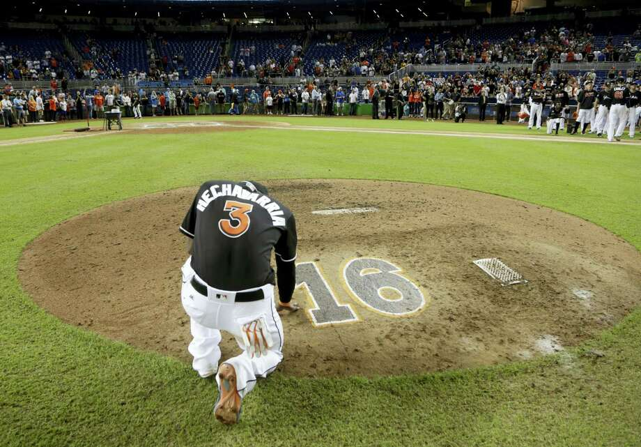 The Marlins' Adeiny Hechavarria (3) touches the pitcher's mound with the No. 16 on it in honor of Marlins pitcher Jose Fernandez, who was killed in a boating accident in Miami last Sunday. Photo: The Associated Press  / Copyright 2016 The Associated Press. All rights reserved.