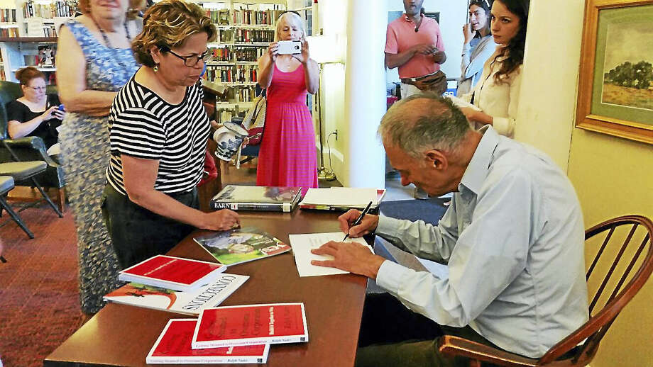 "Photo by N.F. Ambery Renowned consumer advocate and author Ralph Nader signs copies of his 2011 book ""Getting Steamed to Overcome Corporatism: Build It Together to Win"" after reading excerpts at the Beekley Community Library at 10 Central Avenue in New Hartford on Saturday, July 23. Nader answered questions from visitors and donated 100 percent of its proceeds from the book sale to benefit the library. Photo: Journal Register Co."