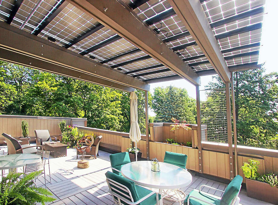 Contributed photoSolar canopies can help homeowners save energy. Photo: Journal Register Co.