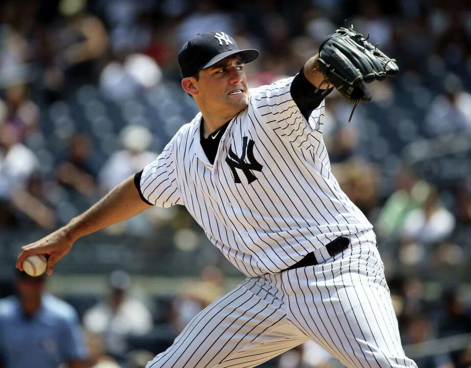 Yankees starting pitcher Nathan Eovaldi throws during the first inning Sunday against the Giants. Photo: Seth Wenig — The Associated Press  / Copyright 2016 The Associated Press. All rights reserved. This material may not be published, broadcast, rewritten or redistribu