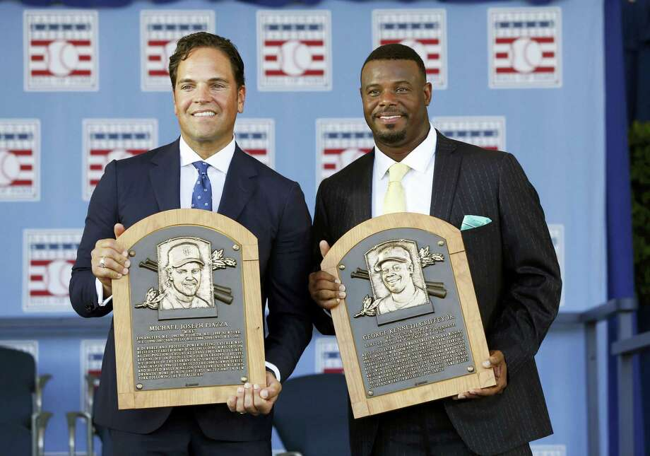 National Baseball Hall of Fame inductees Mike Piazza, left, and Ken Griffey Jr. hold their plaques after an induction ceremony on Sunday in Cooperstown, N.Y. Photo: Mike Groll — The Associated Press  / Copyright 2016 The Associated Press. All rights reserved. This material may not be published, broadcast, rewritten or redistribu