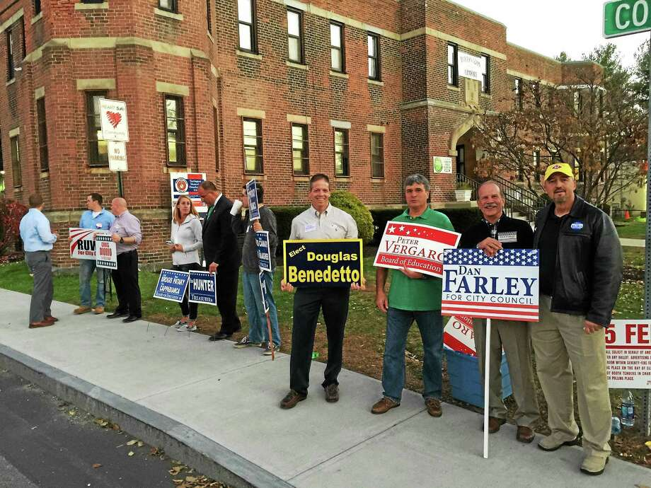 Candidates gather outside of the Torrington armory during the 2015 Torrington municipal elections. Photo: BEN LAMBERT — The Register Citizen