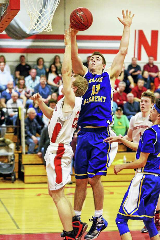 Bacon Academy 6-foot-5-inch center Austin Prevost dominated the boards against Northwestern in the Bobcats' big Class M second round win Thursday night at Northwestern High School. Photo: Photo By Savage Frieze