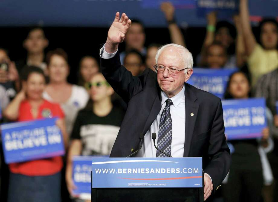 Democratic presidential candidate, Sen. Bernie Sanders, I-Vt., waves to his supporters at a campaign rally Tuesday in Miami. Photo: ASSOCIATED PRESS  / AP