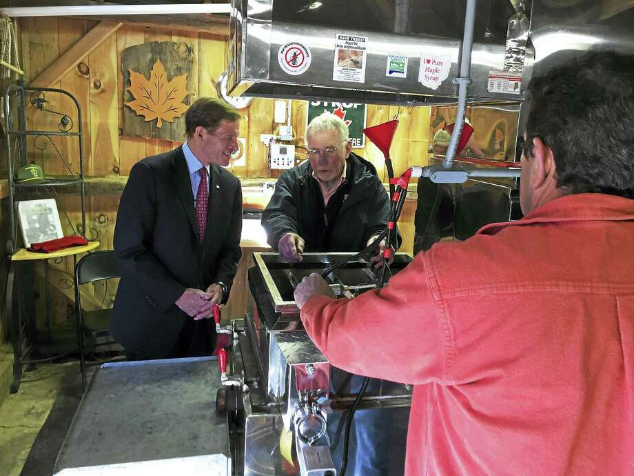 U.S. Sen. Richard Blumenthal toured the maple syrup operation at Brookside Farm II in Litchfield Friday with owner Mark Harran. Photo: BEN LAMBERT — The Register Citizen