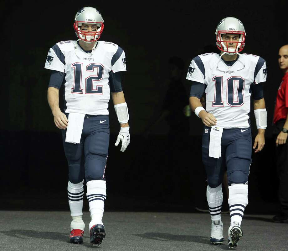 The Patriots will be without quarterback Tom Brady (12) for the first four games this season. Jimmy Garoppolo (10) is likely to see the bulk of the action in training camp. Photo: The Associated Press File Photo  / Copyright 2016 The Associated Press. All rights reserved. This material may not be published, broadcast, rewritten or redistribu