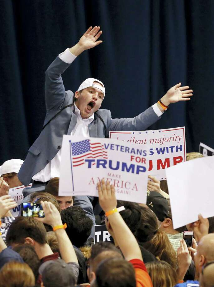 A supporter of Republican presidential candidate Donald Trump tries to pump up the crowd before it was announced the rally had been canceled on the campus of the University of Illinois-Chicago, Friday, March 11, 2016, in Chicago. Photo: AP Photo — Charles Rex Arbogast / AP