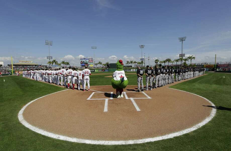 The Philadelphia Phillies' mascot stands at home plate during the national anthem before a spring training game against the New York Yankees on Tuesday in Clearwater, Fla. Photo: Lynne Sladky — The Associated Press  / AP